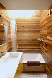 small Japanese bathroom with light warm wood all over to make it look  refined