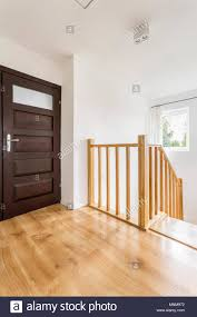 Simple Wood Stairs Design Home Corridor With Brown Doors And Wooden Staircase With