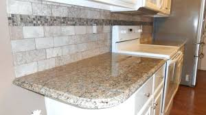 new venetian gold granite with white cabinets fireplace and distributors ex 6 crop