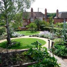 Small Picture A round lawn sets the tone for a manicured landscape Round