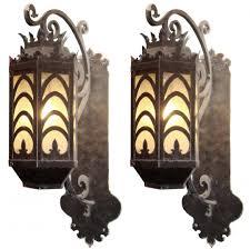 fabulous pair of large iron art deco exterior sconces
