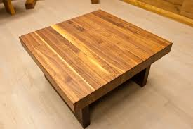 small and low square wooden butcher block coffee table for small living room spaces ideas