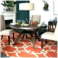 rug under kitchen table area