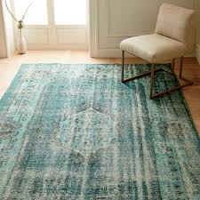 caspian distressed rug overdyed green