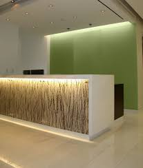 beautiful ikea reception desk with green wall color and charming led lighting