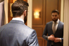 business man looking in mirror. view from back of bearded man looking at the mirror royalty free stock photography business in n