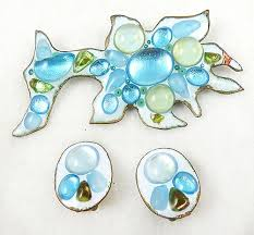 description ruth buol fused glass over copper brooch and clip earrings set the brooch is sort of an abstract fish design with a super pale blue almost