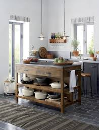 Like a treasured vintage find or a custom-designed piece, this elegant kitchen  island serves as a rustic yet refined workstation for the home cook or ...