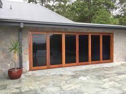 tile floors and installing bifold doors with stone siding