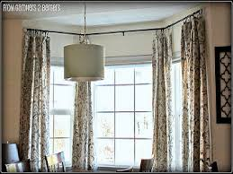 how to install bay window curtain rods effectively