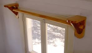 appealing wooden curtain rods which is painted in glossy brown to mix with white door