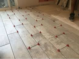 tile self leveling system atr tile leveling system t shape kit flooring supply throughout floor tile self leveling system