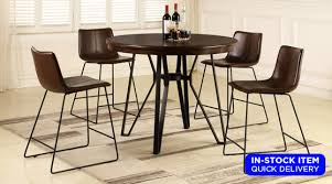 crafted of solid hardwood this dining table set comes complete with a round kitchen or dining room table and 4 parson chairs