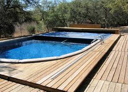 Image Decking Aboveground Pool Pictures The Spruce Aboveground Swimming Pools Designs Shapes And Sizes