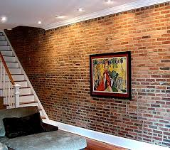 Stylish Basement Cave Man Decors Ideas With Artwork Picture Hang On Classic  Exposed Brick Wall Feat Ceiling Light Fixtures And White Wooden Staircase  ...