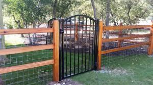 cedar split rail with custom ornamental iron gate