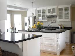 Of White Kitchens With Dark Floors White Kitchen Cabinets With Black Granite Aria Kitchen