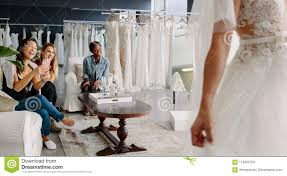 Design A Friend Wedding Dress Friends With Bride In Bridal Dress Fitting Room Stock Image