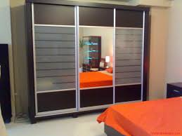 Amazing Small Bedroom Cupboard Idea With Orange Bedding Plus Black Chrome  Cupbaord Using Mirror And Shelves