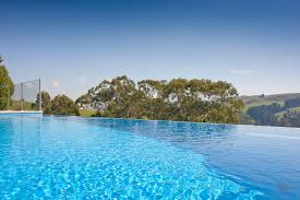 infinity pools edge. How Much Does An Infinity Edge Swimming Pool Cost? - Compass Pools Melbourne