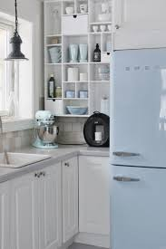 Mia Interiors: Ice blue and white Norwegian kitchen / colors & open shelving