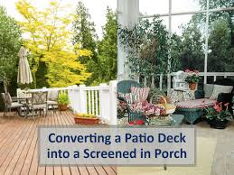 a patio deck into a screened in porch