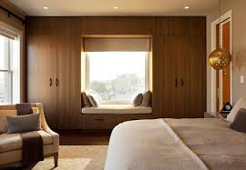View in gallery Mahogany window seat and bedroom closet