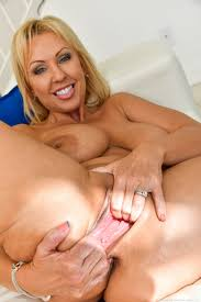 Buxom blonde MILF stretches cunt for huge dildo and bottle.