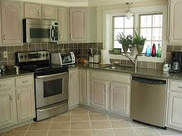White washed kitchen cabinets Cream Colored Kitchen After Whitewashing Kitchen Cabinets refrig Side By Ashley Spencer Ashley Spencer Whitewashed Kitchen Cabinets Finishes Ashley Spencer