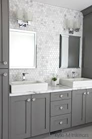 bathroom vanity uk company countertop combination: the countertop is formica quotcalcutta marblequot marble backsplash in hexagon shape with vanity cabinets painted chelsea gray double sinks and chrome accents by