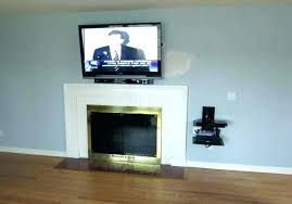 mount tv to wall above fireplace wires wall mounted hiding wires gorgeous mount on brick fireplace hide wires minimalist of best shelf how to mount over