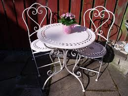 the san remo antique white bistro set table and two chairs