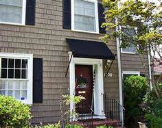 front door awningnice simple easy fix for that no cover no porch overhang  the