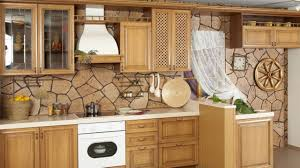 traditional kitchen design of stone backsplash and wall cabinet with glass door also wall utensil holder