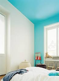 you may have heard of painting the ceiling but here painting the ceiling and a single wall elevates the walls and ceiling into floating panes of color