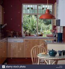 Stained Glass Panels In Window Above Sink And Dishwasher In Kitchen With  Red Enamel Light Fitting Great Ideas