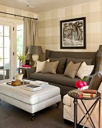 O Cottage Living Room With Tan Gingham Patterned Walls Charcoal Gray  Wingback Sofa Taupe Pillows Directoire Table Light Velvet Ottoman Bench And