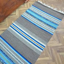 image 0 grey striped rug gray floor blue and