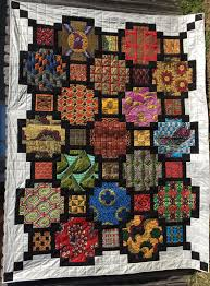 Windows of the World & Join the Quilt Corner in welcoming Michael Young as he teaches Windows of  the World quit class. Adamdwight.com