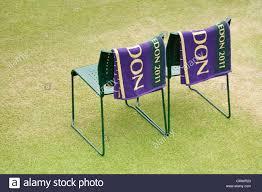 wimbledon players chairs beside a tennis court at wimbledon tennis club england