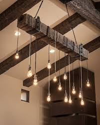 contemporary hanging lighting and wood barn beams luxury rustic family desert house in arizona