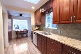 hanging a ceiling fan with traditional kitchen and backsplash cherry cabinets cherry kitchen cherry kitchen cabinets