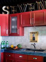 eclectic kitchen with red cabinets
