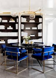 round black dining table with royal blue velvet dining chairs