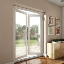 white softwood french doors opening from living room into garden