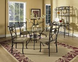 furniture round glass top dining table with black metal bases four carving chairs mocha rug elegant