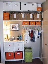 organized infant s closet with labeled storage bins