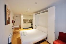 modern furniture small apartments. Elegant Cream Microfiber U Shaped Sectional Sofa Small Apartment Modern Furniture Dark Cherry Wood Wall Mounted Bookshelf Round White Pendant Apartments A