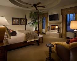 this deluxe master bedroom comes complete with a flat screen television and a breathtaking fireplace with