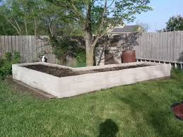 raised bed made from concrete block read comments on website for excellent ideas when using